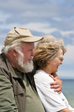 Senior couple looking out at the water Royalty Free Stock Photos