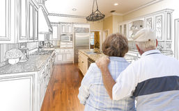 Senior Couple Looking Over Custom Kitchen Design Drawing and Pho. To Combination Stock Photos