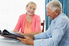 Senior couple looking at photo album Royalty Free Stock Photography