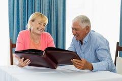 Senior couple looking at photo album Stock Photos
