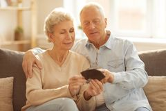 Senior Couple Looking at Pictures stock images