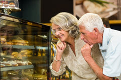 Senior couple looking puddings Royalty Free Stock Image