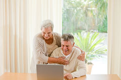 Senior couple looking at their laptop Royalty Free Stock Photo