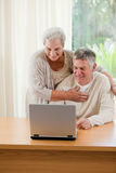Senior couple looking at their laptop Royalty Free Stock Image