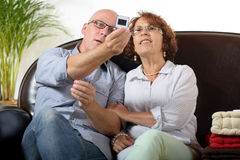 A senior couple looks at a photograph slide Royalty Free Stock Photo