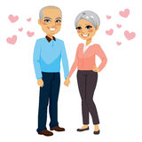 Senior Couple Love. Cute happy senior couple holding hands in love with pink hearts Stock Photos