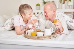 Senior couple in love having breakfast. In their hotel room during their holiday vacation royalty free stock photos