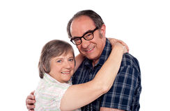 Senior couple in love hugging each other Stock Photos