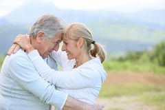 Senior couple in love outdoors royalty free stock photo