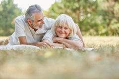 Senior couple in love relaxing on the gras Royalty Free Stock Photo