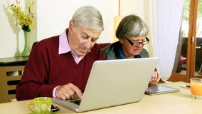 Senior couple in love with technology and social network stock footage