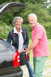 Senior couple with luggage Stock Photography
