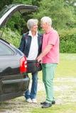 Senior couple with luggage Stock Photo