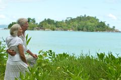 Senior couple in lush bushes Royalty Free Stock Images
