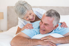 Senior couple lying in bed Royalty Free Stock Image