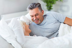Senior couple lying in bed. Together Royalty Free Stock Photography