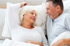 Senior couple lying in bed. Together Stock Photography