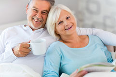 Senior couple lying in bed. Together Royalty Free Stock Photo