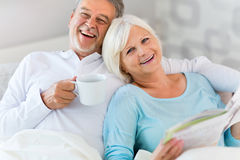 Senior couple lying in bed. Together Stock Photo