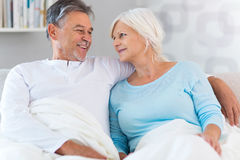Senior couple lying in bed. Together Royalty Free Stock Photos