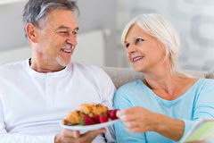 Senior couple lying in bed. Together Royalty Free Stock Image