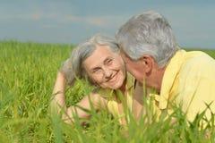 Senior couple lying Stock Photos