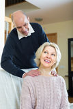 Senior couple making a back massage Royalty Free Stock Photography
