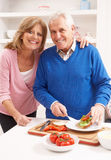 Senior Couple Making Sandwich In Kitchen Royalty Free Stock Image