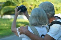 Senior couple making self portrait. Cute senior couple making self portrait outdoors Royalty Free Stock Photos