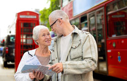 Senior couple with map on london in city street Stock Photos