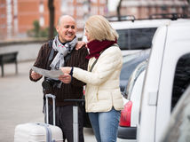 Senior couple with map and luggage Stock Image