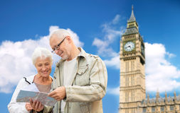 Senior couple with map over london big ben tower Royalty Free Stock Images