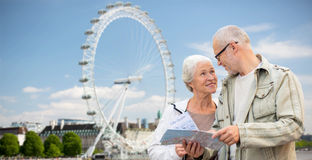 Senior couple with map talking over london Royalty Free Stock Photography