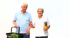 Senior couple after the market stock footage