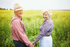 Senior couple in meadow Royalty Free Stock Photo