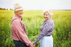 Senior couple in meadow Royalty Free Stock Photo
