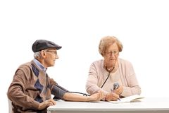 Senior couple measuring blood pressure stock image