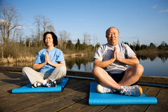 Senior couple meditating Royalty Free Stock Image