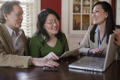 Senior couple meeting with agent stock photo