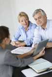 Senior couple meeting architect discussing construction Royalty Free Stock Photo