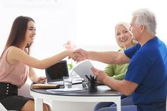 Senior couple meeting with consultant