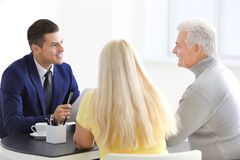 Senior couple meeting with consultant. In office Royalty Free Stock Image