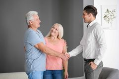 Senior couple meeting with consultant. In office Stock Images