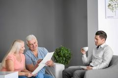 Senior couple meeting with consultant in office