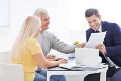 Senior couple meeting with consultant. In office stock image