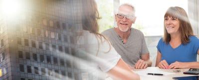Senior couple meeting financial adviser; multiple exposure stock photos