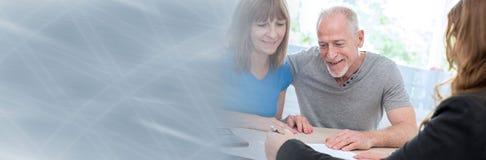 Senior couple meeting financial adviser. panoramic banner stock photos