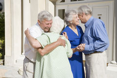 Senior couple meeting friends Royalty Free Stock Photo