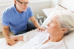 Senior couple meeting at hospital ward Stock Photos