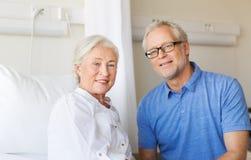 Senior couple meeting at hospital ward Stock Photo